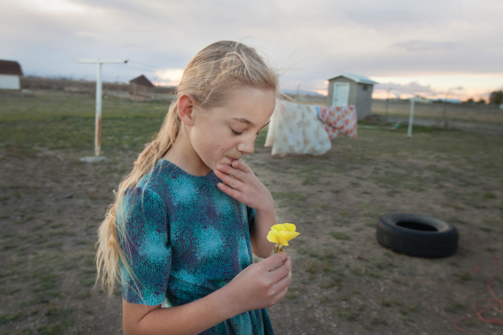 <small>Middle child Maria picks the first flower of spring instead of leaving it for the new tenants.</small>