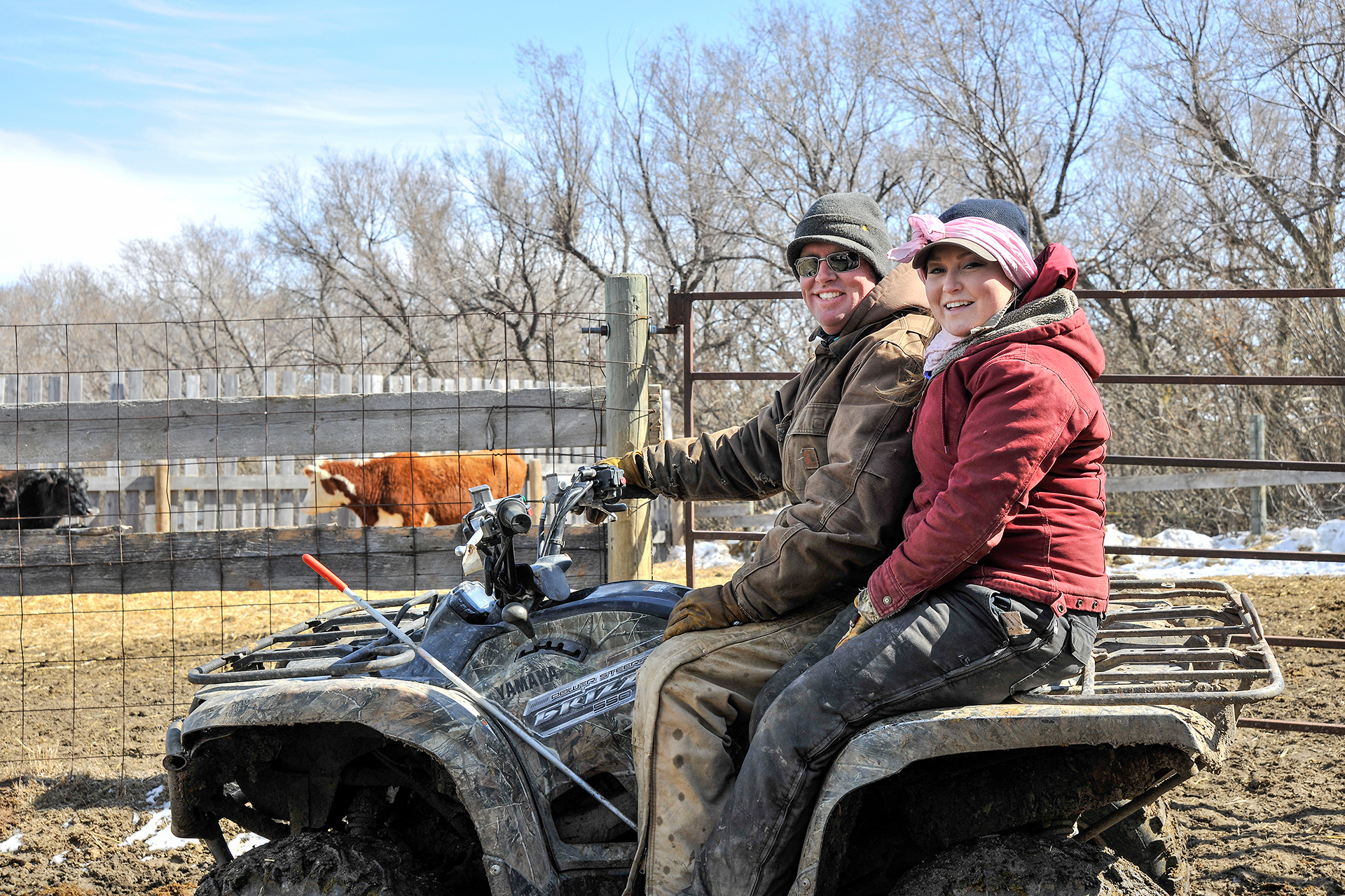 Arnal and her fiancé, Leigh Bircham, check on some cows.