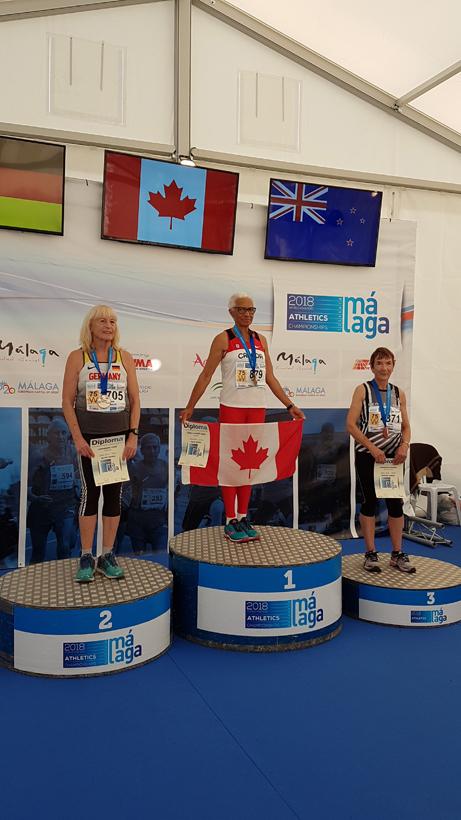 Carol LaFayette-Boyd at podium with flag.