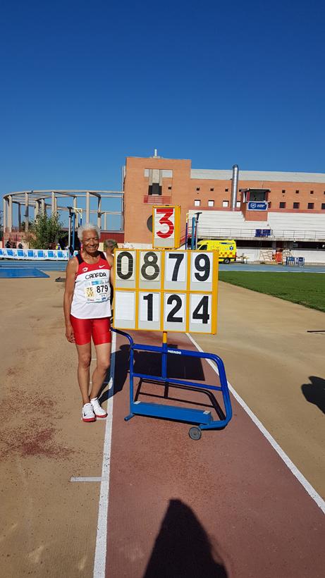 Carol LaFayette-Boyd standing by scoreboard