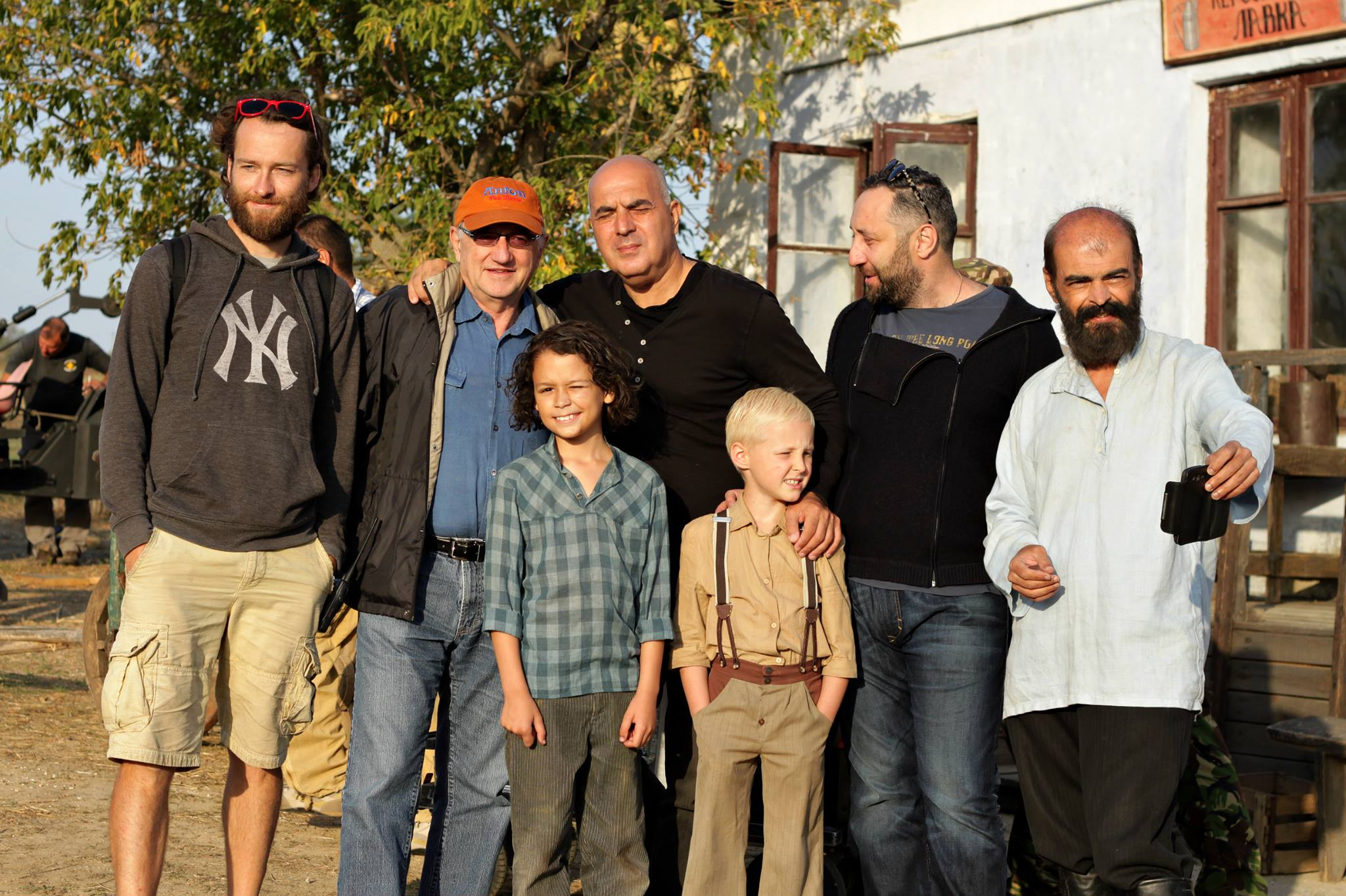 On the set in a small village near Odessa, Ukraine. From left to right: Director of Photography Mikhail Petrenko; Dale Eisler; Director Zaza Urushadze; co-producer Mirza Davitaia; actor Vladimer Levitzki. Front row left to right Mykyta Dziad who plays Jacob, Nikita Shlanchak who plays Anton. Photo courtesy of Dale Eisler
