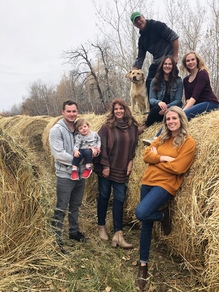 Family time on the farm: clockwise from top – Tucker the yellow lab, Dad Charlie, sister Katelyn, Danielle, sister Larissa, Mom Lisa, nephew Bennett, and Larissa's husband Brandon.