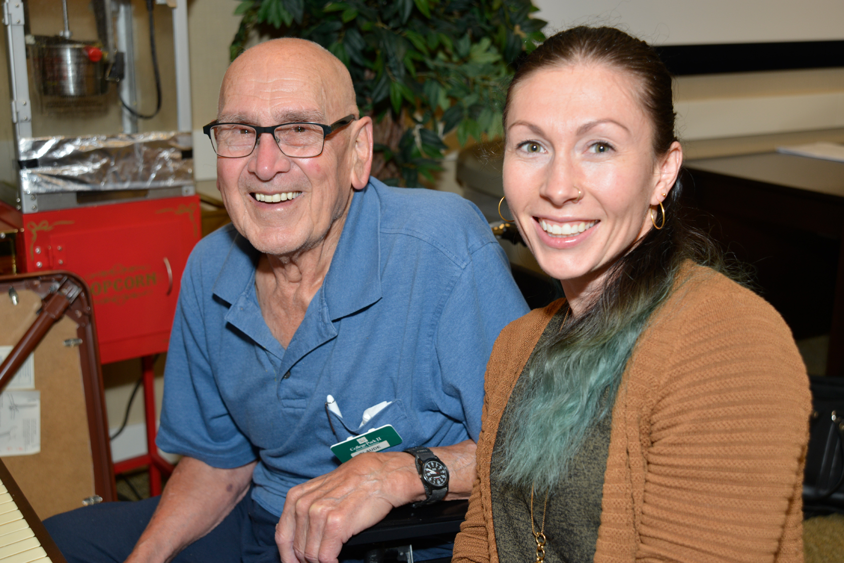 Mandy Ebel, a singer-songwriter, vocal coach, and music producer is one of the program volunteers. She regularly visits College Park II to help Claude Crozon learn and re-learn songs after a stroke and two mild heart attacks left him without memories. Photo by Don Hall