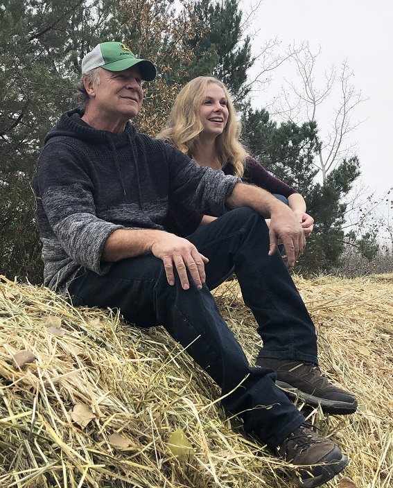 Danielle enjoys a much-deserved break with her dad, Charlie, after a day of cattle chores.
