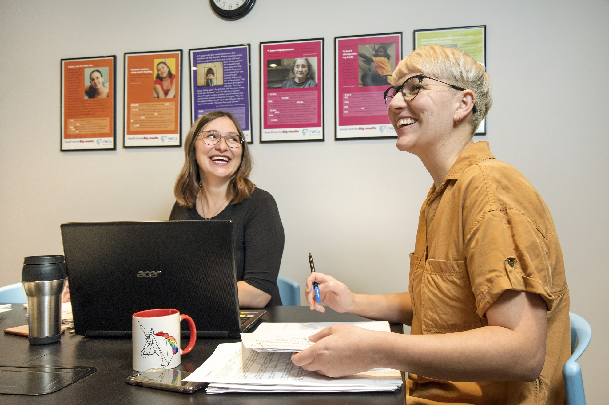 Lindsay Dell (left) and Tara Molson share a laugh during a morning meeting at YWCA Regina. Photo by Trevor Hopkin