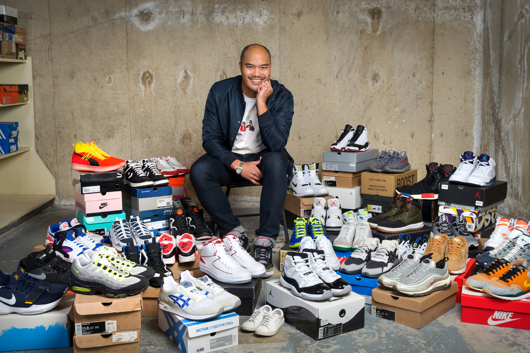 By his estimate, Pulga has between 80 and 90 pairs of basketball sneakers. Some, he admits, he has never worn. Photo by Trevor Hopkin