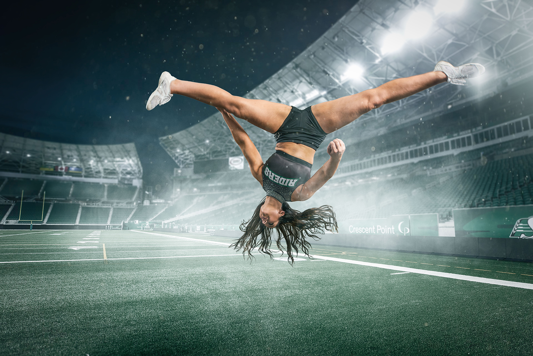 <small>Alexa Kupchyk, a fourth-year U of R psychology student and member of the Saskatchewan Roughriders 620 CKRM Rider Cheer Team defies gravity in this photo entitled Riders Cheer.</small>