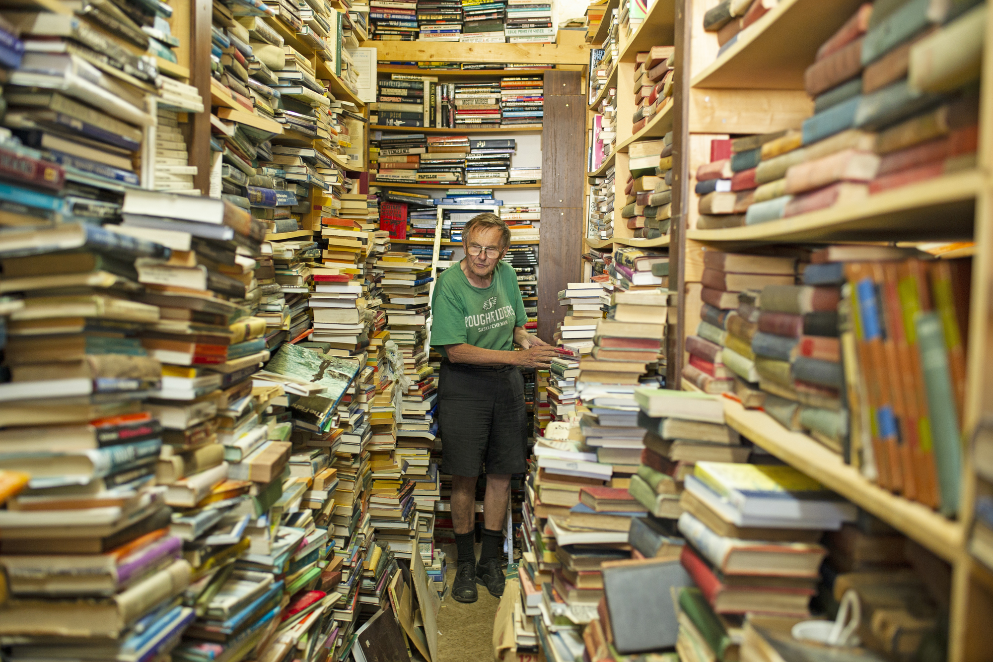 <small>Ralph Crawford works his way down an aisle in his bookshop in Perdue, Sask., population 334. I've always loved driving 