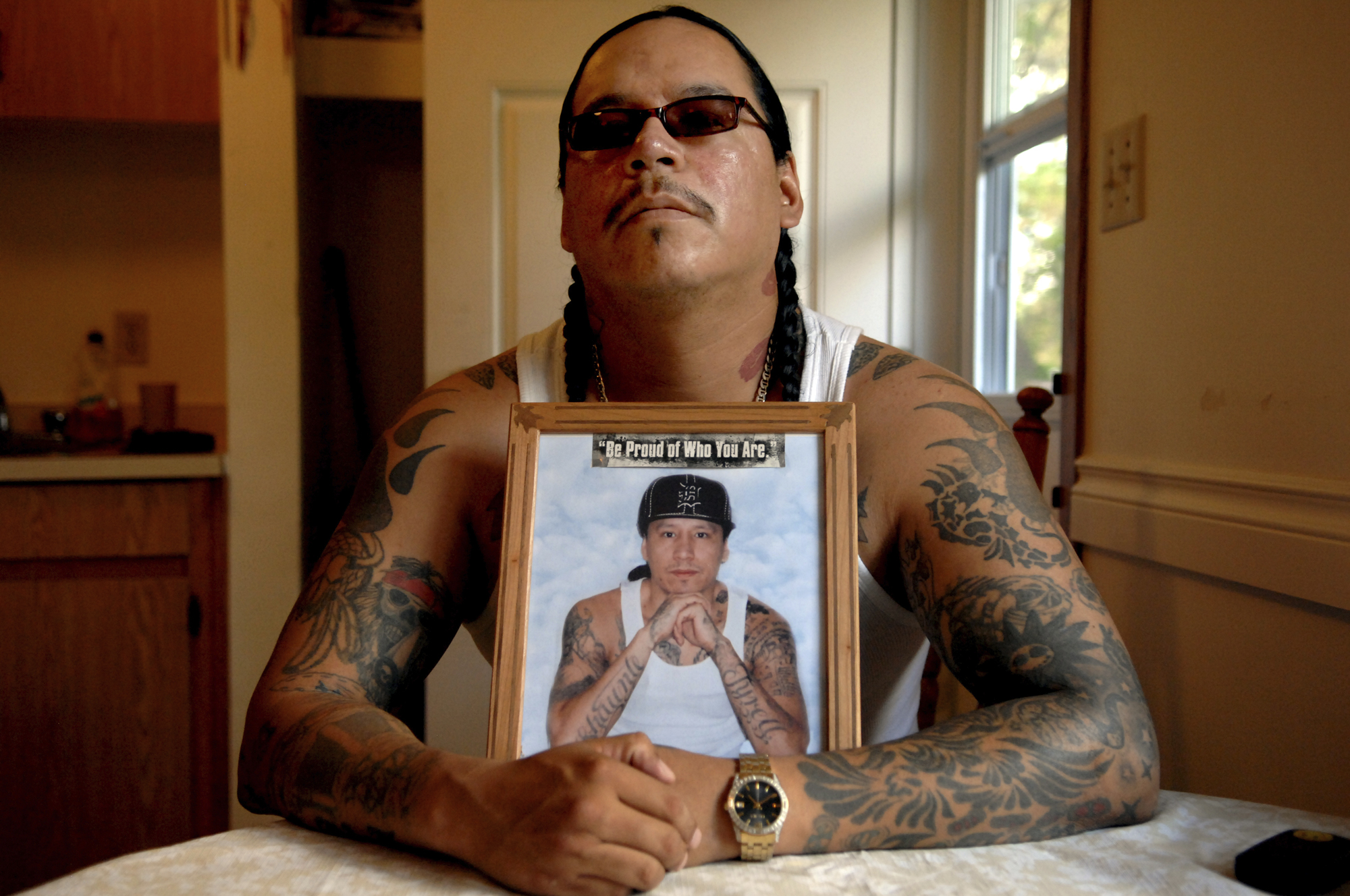 <small>Richard Wolfe sits at his kitchen table in Fort Qu'Appelle, Sask. Wolfe and his late brother Daniel (in picture) founded the 