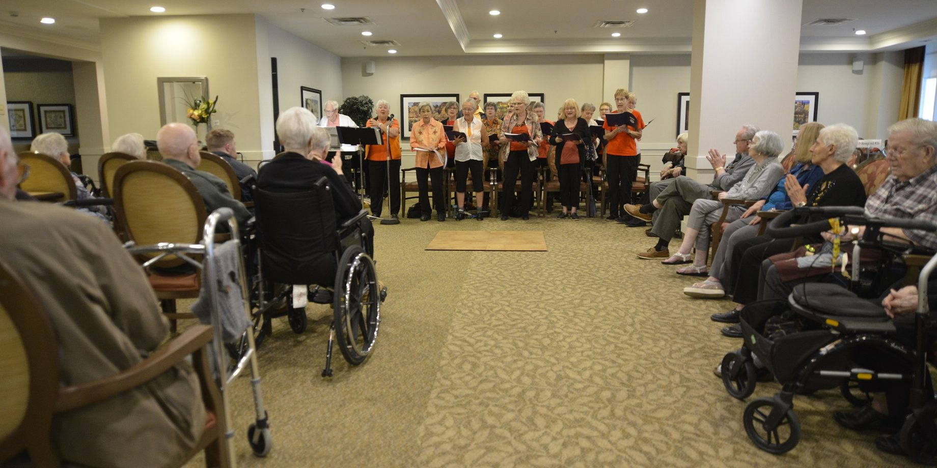 Residents of College Park II, a retirement residence, are entertained by a local choir. A landmark 2013 study by the Montreal Neurological Institute showed clearly the benefits music has on the brain. Photo by Don Hall